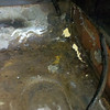 Passenger floor after removing the patch and plastic filler.